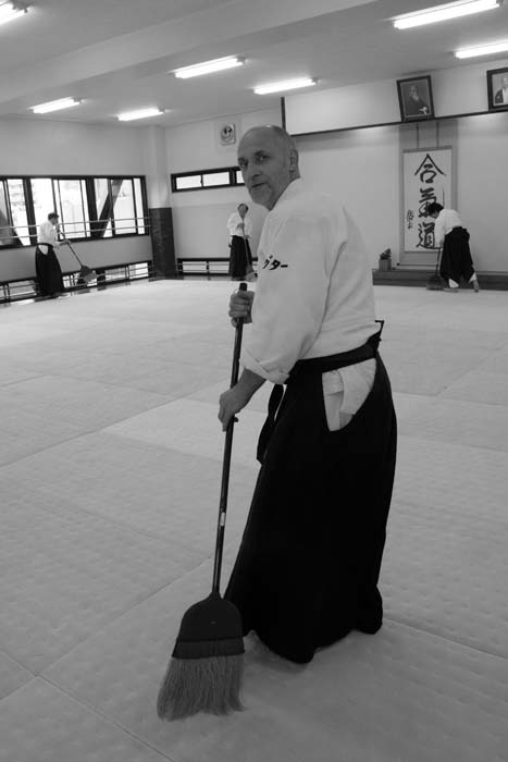 Philippe Gouttard, 6th Dan Aikikai sweeping the tatami at the end of the class