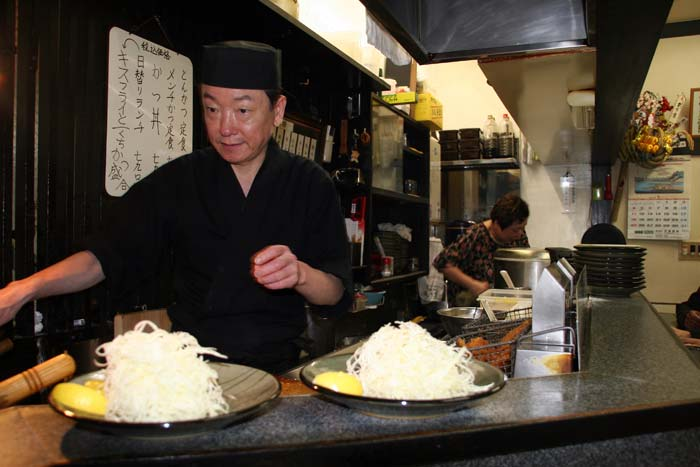 chef preparing a tonkatsu dish